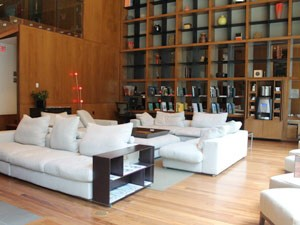 Inside the lobby, featuring white sofas and racks