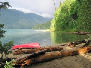 Landscape view of National Park with Canoe in Lake