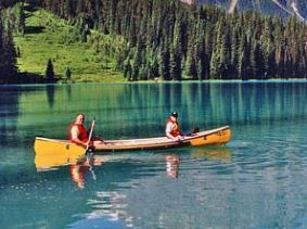 Customers canoeing on a lake in National Park
