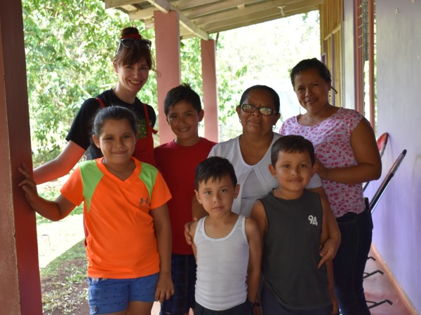 Jen with local family at homestay