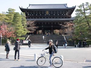 Product Specialist Sophia cycling in Kyoto