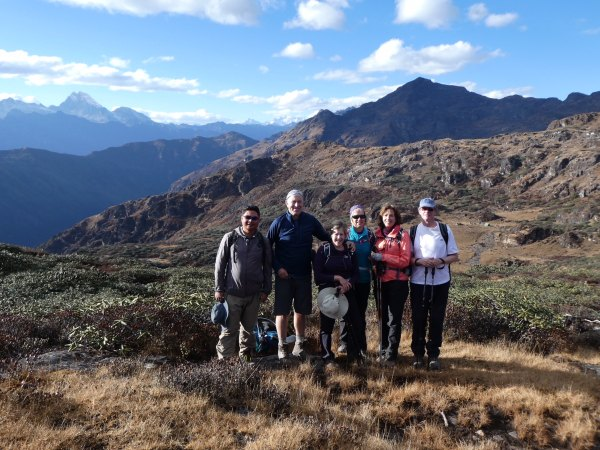 Group of people smiling whilst trekking through Bhutan