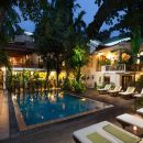 Swimming pool at night at Villa Langka in Phnom Penh