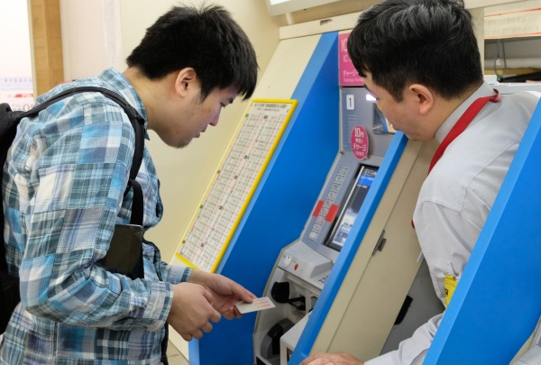 Person buying Japan rail ticket
