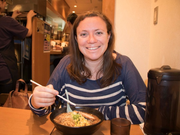 Woman eating Japanese food with chopsticks