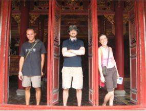 People standing in doorways of Hue temples