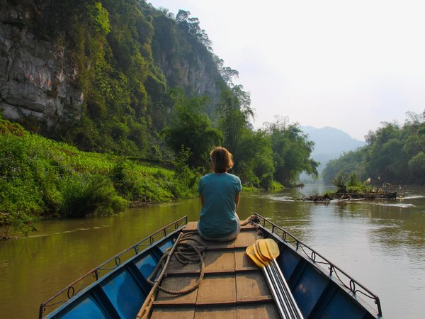 woman taking boat trip in ba be national park looking at limestone karsts