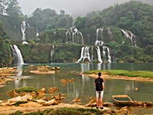 man starting at ban gioc waterfall
