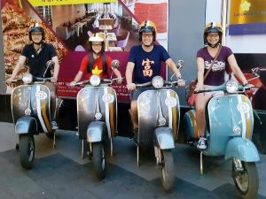 family on vespas in ho chi minh city