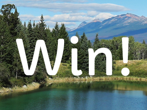 Image of a lake and mountains with the word win on top
