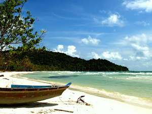 Fisherman boat on a sandy beach on Phu Quoc island, Vietnam