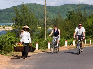 couple cycling around vedana lagoon