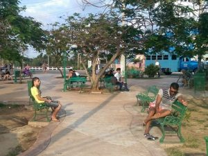 Locals using a WiFi park in Cuba