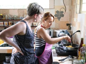 Our Cuba Specialist Jules taking part in the cookery experience in Sancti Spiritus