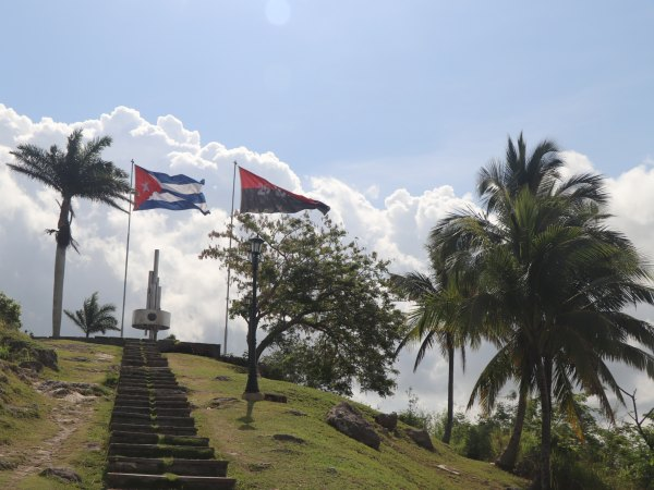 Cuba flag blowing in the wind on hill