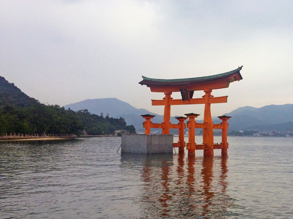 Landscape view of a traditional tori or gate at Miyajima in Japan