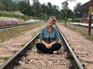 Woman sitting on train tracks in Myanmar