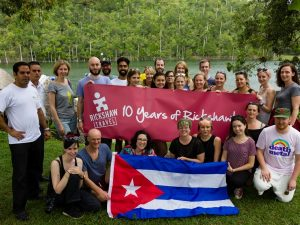 Group photo of Rickshaw staff and 10 year banner
