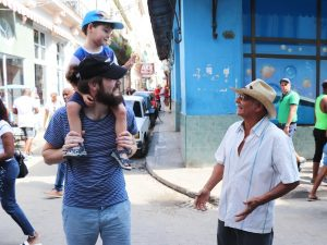 Father and Son smiling with local Cuban man