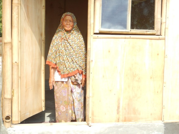 Local women standing at doorway in Indonesia