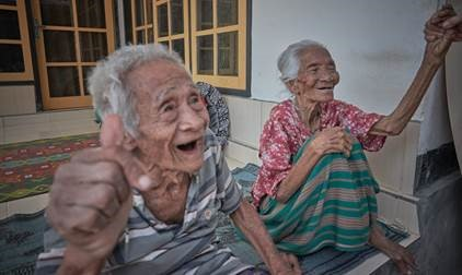 Happy Indonesian locals smiling