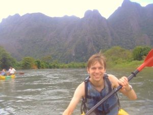 Customer kayaking in Vang Vieng, Laos
