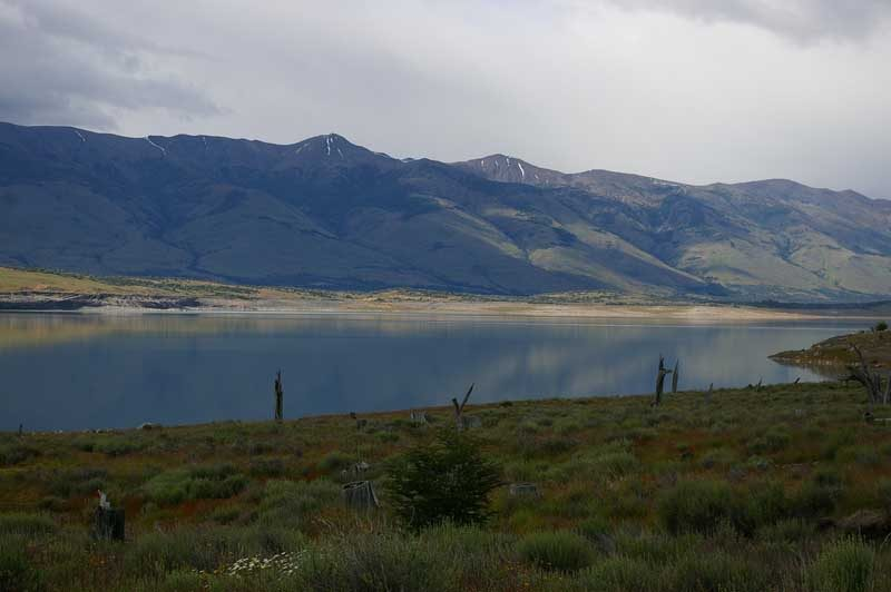 Mountains and lake with grass