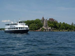 Boat cruising Ontario Lake with Castle in background