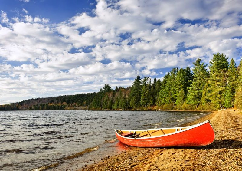 red canoe on beach at lake of two rivers