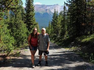 Customers hiking through park in Canada