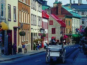 Old Quebec town with houses and carraige
