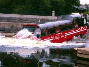 Bus turning into a boat and going through water