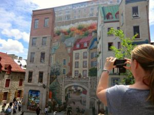 Women taking photo of the art in Quebec City