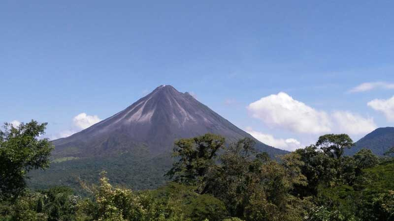 Arenal Volcano with blue skies