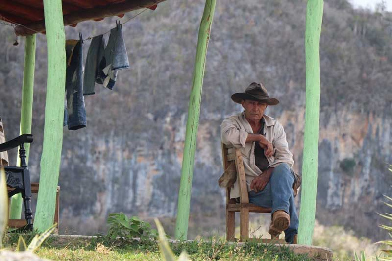 Man sitting on a porch in vinales
