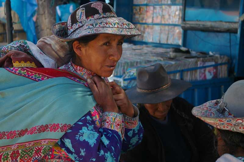 Local Peruvian woman wearing blue clothes and hat