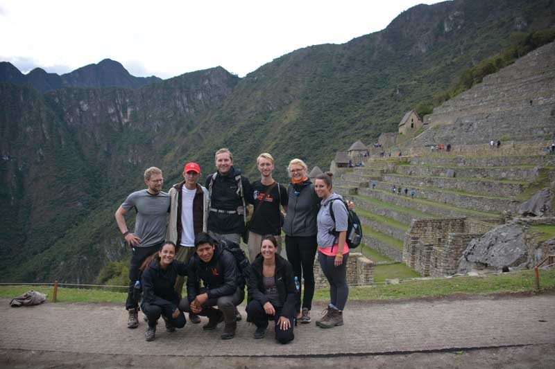Group of people in Peru Inca Trail ruins
