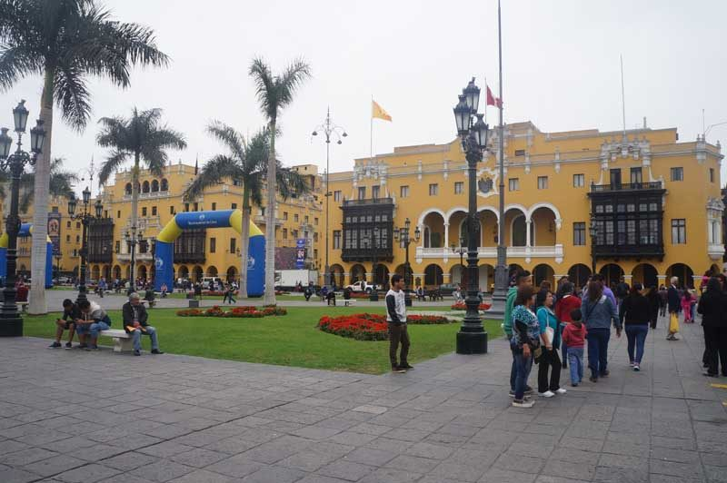 People standing in the square in Lima
