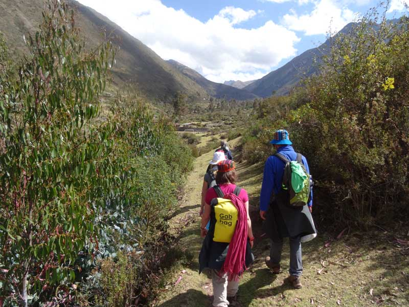 Two people trekking through valley