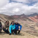 people in front of rainbow mountain peru