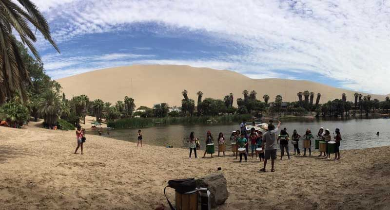 Peru - huacachina - local band - landscape