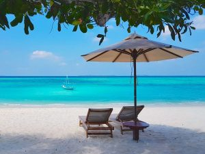 Beach and turquoise ocean of Hanimadhoo Island in the Maldives
