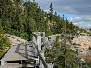 Wooden bridge going along the cliffs