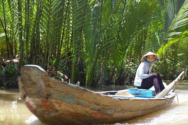Cambodia Mekong local lady in boat