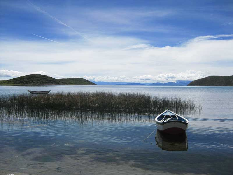 row boat on lake titicaca peru