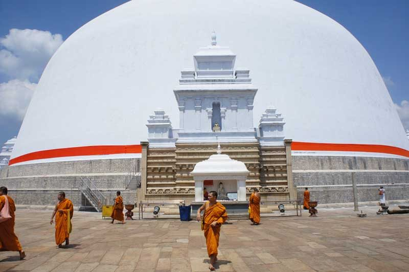 White temple with monks in front