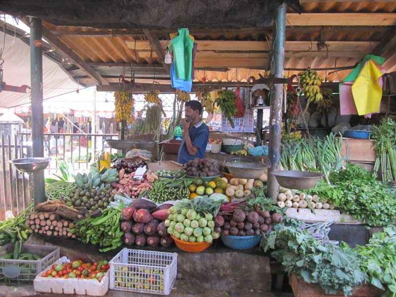 Fruit market with market trader in Kandy Sri Lanka