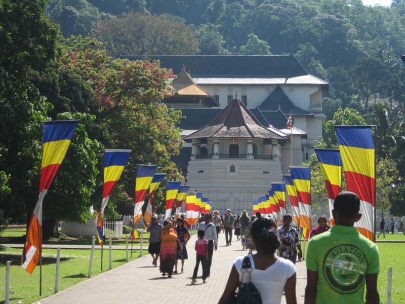 Sri Lanka temple with colourful flags and people