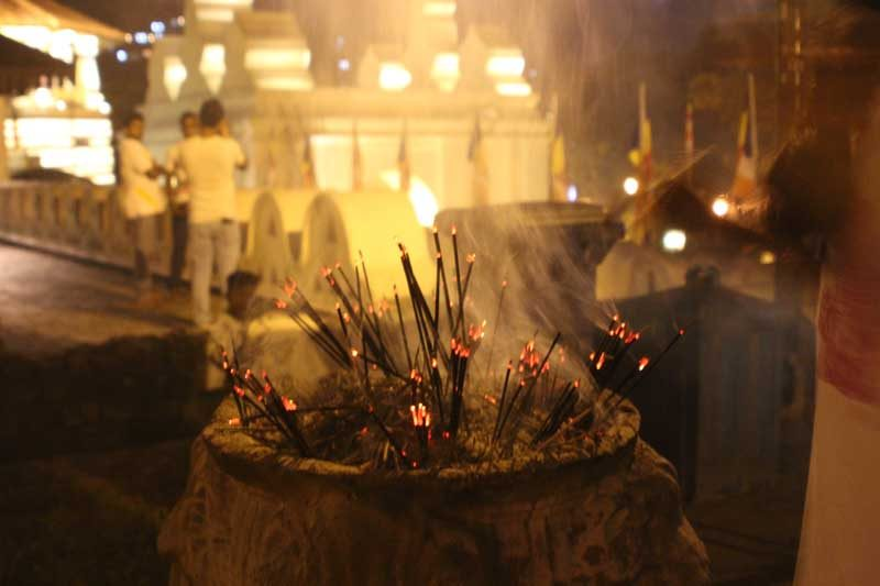 Burning incense in Kandy temple, Sri Lanka