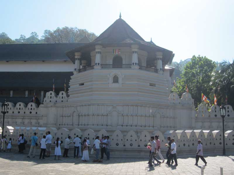 Temple in Kandy with people in front